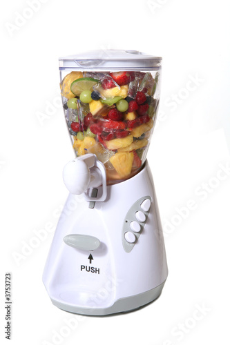 canvas print picture Colorful fruit and ice in a blender