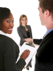 A business team conducting an interview with a job seeker
