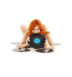 Fototapety playful redhead with vinyl records over white