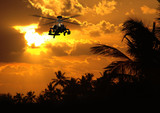 Photorealistic 3D render of Apache helicopter at sunset. poster