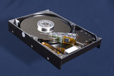 Horizontal image of a Hard Disk Drive, opened up. poster