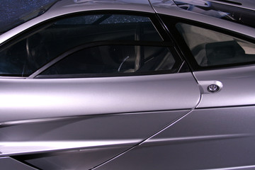 side of silver supercar