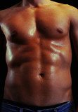 Handsome shiny naked muscular male body isolated on black poster