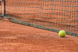 Detail of clay tennis court. Tennis ball and net poster