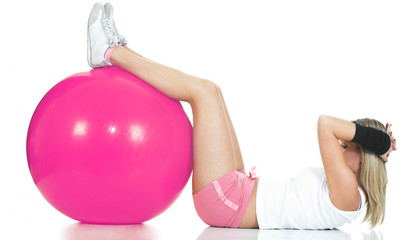 Pilates trainer doing stomach exercise. Pink Pilates ball
