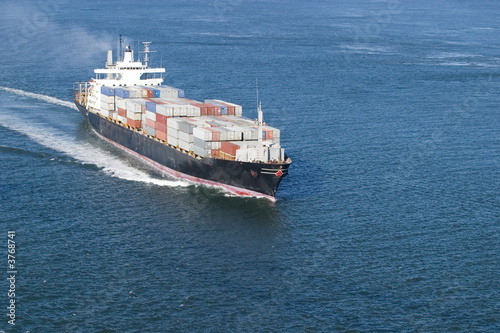 Leinwanddruck Bild Cargo Boat with room in front