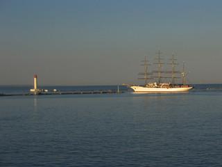 Retro schooner leaving a port