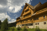 Luxury traditional mountain hotel made of wooden planks. poster