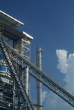 Detail of processing plant with conveyor belt and smoke stack poster