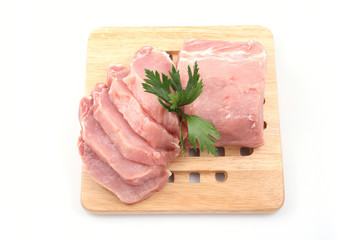 boneless pork loin on board - isolated on white