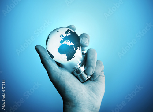 A man holding a bulb with the world on it.