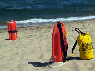 Ocean Rescue Gear -- Patrol Rescue Can and Rope Bag near Water