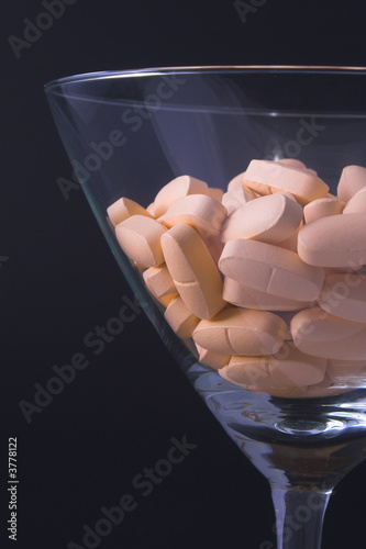 poster of Pills in a martini glass - Drug abuse concept.