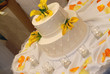 Wedding cake at a reception surrounded by tea candles