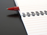 notepad with pen poster