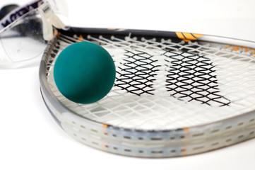 Close up shot of racquetball gear on a white background.