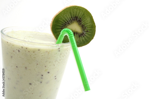 glass of fresh kiwi smoothie and some fresh fruits isolated