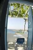 greek island view guest house with grape arbor  tile patio poster