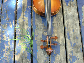 Violin over the blue painted porch.