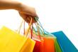 Leinwanddruck Bild - A woman hand carrying a bunch of colorful shopping bags