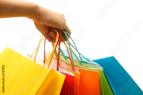 A woman hand carrying a bunch of colorful shopping bags - 3787952