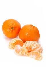 Mandarins, whole and peeled, isolated on white.