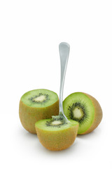 Kiwi fruit with spoon, isolated on white.