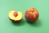 Peach and half peach with stone. Fruit. Nutrition. poster