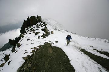 Woman climbs to snowy peak