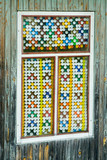 Old window decorated by fuses poster