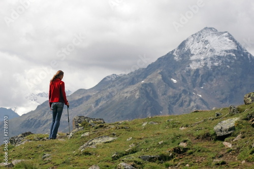 Young woman hiker having a rest after long walk in mountains.