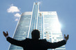 Businessman Raising Arms at Skyscraper