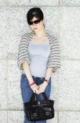 asian girl with handbag outdoors