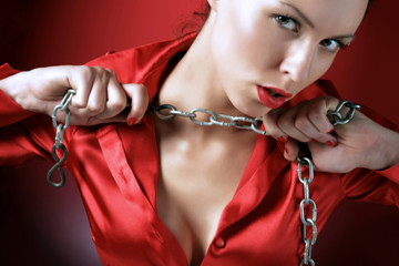 girl in red is holding metal chain