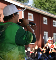Rapper in action on stage in front of a crowd