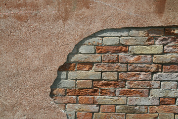 Antico muro di mattoni