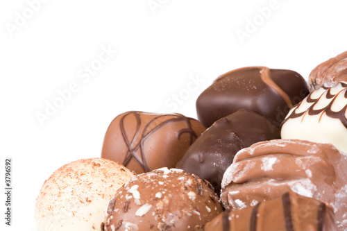 Chocolates isolated with white copy space