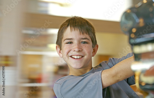 Boy with Blurred Background on Merry go Round