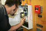 electrician wiring a fire alarm system  poster