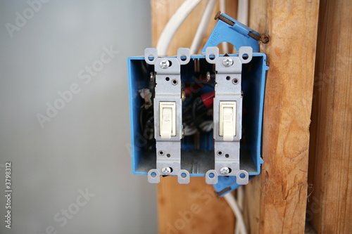 A two gang, 120 volt single pole electrical switch box