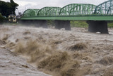Fototapety Raging waters of the Fuji River during a Typhoon