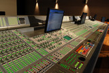 audio mixing console in post production studio poster