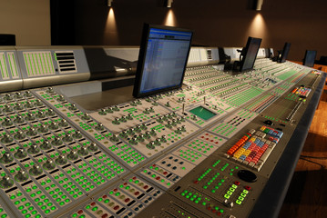 audio mixing console in post production studio