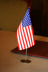 American Flag on negotiating table