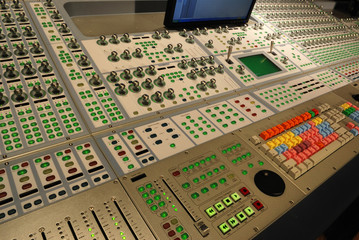 panel of buttons on audio mixing console