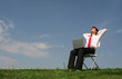 Man sitting outdoors using laptop