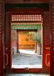 Looking through doors in the Forbidden City in Beijing