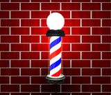 Barber pole on brick wall poster