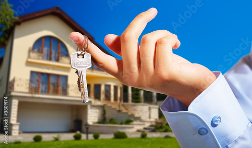 House owner/real estate agent giving away the keys - 3809174
