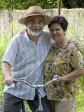 senior couple bicycling poster
